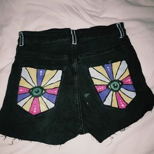 Black jean shorts with acrylic painting on pockets